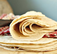 Warm, fresh, homemade tortillas~Just like my abuela used to make. She'd flip them onto a plate and the kids would be ready with butter. The more she'd make, the more we'd eat!