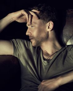 """Tom Hiddleston Gives Himself to Charity, to Questions, and to Biscuits in a London Tea Club """"I told you I'd speak in loose metaphors, by the way,"""" says Tom Hiddleston with a wry smile over Earl Grey tea and a slice of lemon cake, as he begins to pick apart the perspective-shattering ex"""