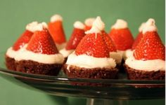Here is one of the most adorable holiday treats I've seen yet -- Santa hat brownie bites. I  saw them over at Sweet Tooth, and I was smi. Noel Christmas, Christmas Desserts, Holiday Treats, Christmas Treats, Christmas Baking, Holiday Recipes, Christmas Parties, Christmas Brownies, Tacky Christmas
