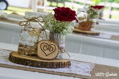 Inexpensive Wedding Centerpiece Ideas using mason jars and burlap | Other flower arrangements were done using tin cans, burlap, lace ...
