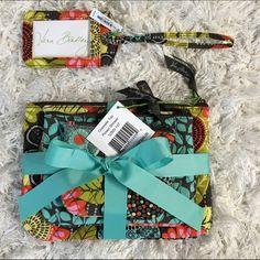 Vera Bradley Flower Shower cosmetic trio & ID tag New with original tags!  Set of 3 bags & 1 luggage or bag ID tag.  Interior of bags are lined with white plastic/vinyl for easy wipe down cleaning. Vera Bradley Bags Travel Bags