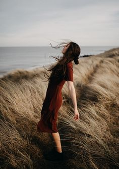 By The Wildlings Photography. Girl falling into the wind at the beach, windswept hair, sand dunes and rust dress Art Photography Portrait, Beach Portraits, Beach Photography, Creative Photography, Fashion Photography, Photography Editing, Digital Photography, Portrait Inspiration, Photoshoot Inspiration
