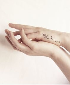 let go paper airplane tattoo #tattoo #girl #airplane #hand #black www.loveitsomuch.com Let It Go Tattoo, Real Tattoo, Tattoo You, Whimsical Meaning, Paper Airplane Tattoos, Tattoo Paper, Paper Plane Tattoo, Diy Tattoo, Piercing Tattoo