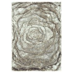 Bring visual interest to your living room, den, or master suite with this artfully hand-tufted rug, showcasing a luxe shag design and oversized floral-inspir...