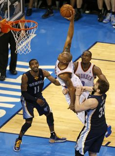 Oklahoma City's Caron Butler (2) goes by Memphis' Marc Gasol (33) for a dunk as Mike Conley (11) and Oklahoma City's Serge Ibaka (9) watch d...