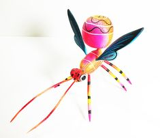 This vibrantly yellow dream wasp wont have to do much to fly its way into any conversation. Its carefully hand-painted blue and wings, along with its incredibly detailed body are sure attention-grabbers and this dreamy little guy will have no problem fitting in any home or office. Hand-sculpted and hand-carved with skill and pride by the Blas Family.  Approx. Measurements - 9 x 6 x 6  _____________________________________________  • Payments are accepted through Paypal. Etsy Gift Cards are…