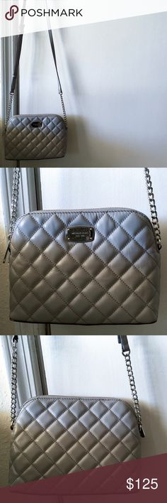 Michael Kors Crossbody This crossbody is light grey/silver in color, with an elegant quilted look. It is absolutely gorgeous. Photos do not do it justice. There is light wear on the hardware, but otherwise this bag is in near perfect condition. I've only used it a handful of times. The price is pretty firm because of the fees Posh takes out. I'm sorry, I'm not interested in trades. Michael Kors Bags Crossbody Bags