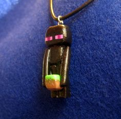 Is it art or is it a Minecraft Enderman Charm Necklace by oxygenimpulse on Etsy, $12.00