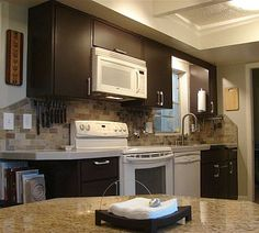 1000 images about kitchen cabinet repair ideas on for Brown kitchen cabinets with black appliances