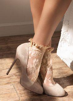 Lacy socks and beige heels.