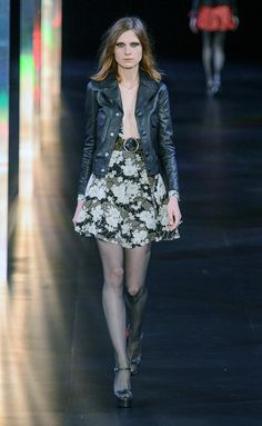 Saint Laurent.  Floral  skirt with leather jacket