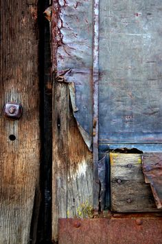 Weathered wood and vintage metal on an old door create a beautiful composition. The high quality giclee print is created in the studio using archival pigment inks on acid free heavyweight paper to max