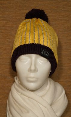 Hat of reflective yarn by STITCHadijumi on Etsy