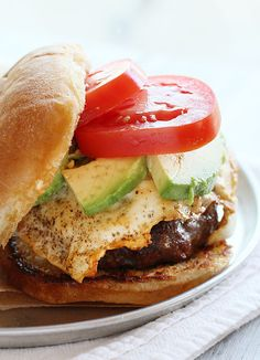 I have a little obsession with burgers. For as long as I can remember, its my go-to meal at any restaurant we frequent. I will pick a burger over a steak any day. And this is my latest obsession. An over-medium fried egg, fresh sliced avocado, and thick sliced Romatomatoes on a grilled