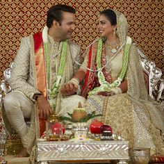Bride Isha Ambani, looks simply stunning in the formal photograph, which shows her dressed in her embroidered couture creation and wearing her mother's wedding sari as a dupatta. Wedding Sari, Wedding Tips, Wedding Photos, Wedding Outfits, Father Of The Bride Outfit, Glamour World, Wedding Rituals, Big Fat Indian Wedding, Garland Wedding