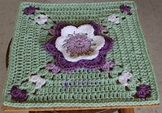 "Easy and fun to make, this 12"" afghan square features a variation of the Tulipe Motif. The beauty of this Tip Toe Through the Tulips square, design by Silverdragon Crafts & Critters is that requires minimal to no blocking, to look that stunning. This 3D flower square is great to make beautiful potholders, blankets, pillows …"
