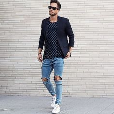Ripped jeans and black blazer . Men's outfit