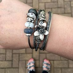 Love the greys and the Anenome with only silvers on the Pandora leather By Marthnickbeads