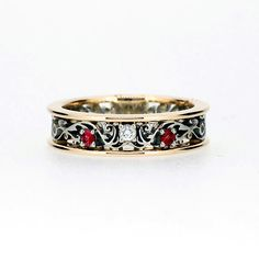 Red sapphire and diamond filigree ring made from yellow and white gold by TorkkeliJewellery