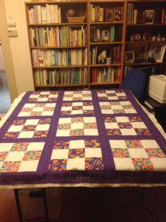 This is the assembled, but not yet quilted 9 square quilt I am helping my developmentally disabled sister make.  She did much of the piecing, I am doing the assembly and machine quilting, (mainly to hold the whole thing together) then she will do some additional hand quilting, after which I will bind the edges,