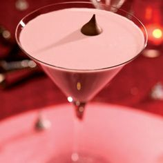 The French Kiss. 1 oz Chambord, 1 oz Vodka, 1 oz dark creme de cacao, 1.5 half and half. Shake ingredients with ice and strain into a cocktail glass.