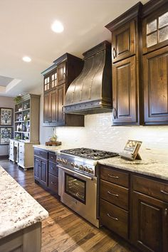 knotty alder, custom cabinetry, kitchen cabinets, stacked cabinet doors, reeded glass, muntins, mullians, crown molding