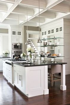 This would be a great kitchen...coffered ceiling, placement of appliances and white :)