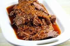 Slow Cooker Barbecued Beef Brisket   Brisket braised with chipotle chile, cumin, paprika, tomato paste, chili powder, ketchup, apple cider, liquid smoke.