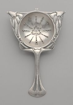 Silver tea strainer, probably designed and made by Horace Potter (American, and Potter Studios (American). Cleveland Museum of Art.