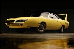 Lemon Twist Yellow 1970 Superbird. To me this car is THE definitive musclecar. Scary fast, available at any Mopar dealership in the U.S. Simply BAAADDD!!!! :-))