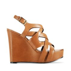 Vince Camuto Shivona Fudge Wedge $110.  Funny with the name!  I have a pair almost exactly like these, but they are Michael Kors.