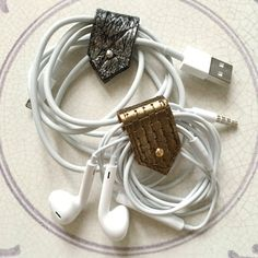 A set of either two or four stylish handmade leather multi-functional tabs in a…