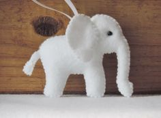 White Elephant Felt Ornament Paisley Baby Elephant Nursery Decor Elephant Christmas White Elephant Gift Handstitched Little Tiny Elephant by KJWcrafts on Etsy https://www.etsy.com/listing/602185627/white-elephant-felt-ornament-paisley