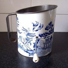 vintage rotary flour sifter.  First time I've ever seen one in the blue willow pattern.