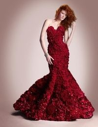 Living flower dress made from red rose petals, chrysanthemums, and more!