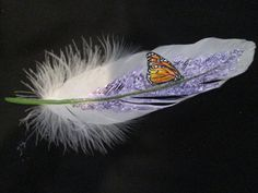 Monarch butterfly on purple lilacs  with by Flutterbyefeathers