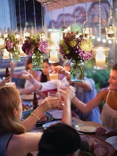 Hanging mason jars and candle holders make this garden setting very romantic.