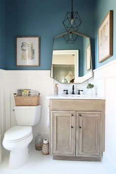 Comes : Barn Seadrift faux finish vanity, matte black hardware, and Behr Color of the Year 2019 Blueprint. See how the white board and batten in the powder room ties it all together! Coastal Powder Room, Powder Room Decor, Powder Room Storage, Powder Room Paint, Blue Powder Rooms, Powder Room Lighting, Powder Room Design, Modern Bathroom Design, Bathroom Interior