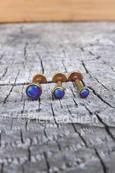 Buy one or all three, pin for later! $21.99 Tragus helix earring cartilage conch stud opal triple forward helix 16g titanium anodized rose gold purple opals body piercing labrets one by SirenBodyJewelry on Etsy