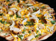 Pizza on the grill is topped with Southwestern ingredients.