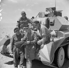 [Photo] The crew of a British Cruiser Mk IV tank studying a map in the Western…