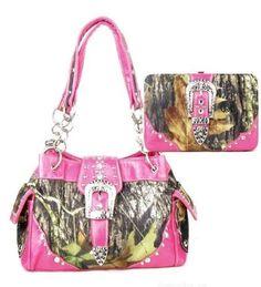 Western Pink Camouflage Buckle Rhinestone Handbag W Matching Wallet. Beautiful matching purse and wallet set. Purse Size: 13(L) X 8.5(H) X 4.5(W). Wallet Size: 7.5(L) X 4.5(H) X 1(W). Feel leather. Beautiful Camouflage Print with Rhinestone Accents.