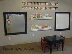 Playroom Update - framed magnet board, framed white board, upcycled end table and chairs, gutter shelves. Great idea for school aged kids. Home Daycare, Daycare Ideas, Preschool Ideas, Church Nursery, Brown Paper Packages, Toy Rooms, Kids Rooms, Kid Spaces, Trends