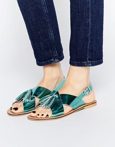 Because teal tasselled sandals are all you need for a luxe summer