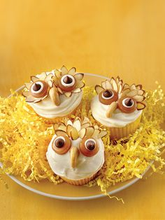 Kids will love decorating these Halloween cupcakes with sliced almonds, candy rings and whole cashews.