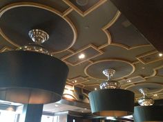 Stretched fabric acoustical ceiling panels conforming to the curves of the adjacent millwork