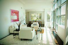Living room with gorgeous windows and natural lighting at Catania Pasadena Condominium Apartments, via Flickr.