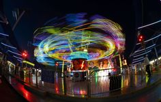 The lights from a ride swirl at the State Fair of Texas in Dallas, Oct. 14, 2015. The State Fair of Texas lasts for three weeks and draws thousands of spectators.