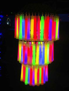 Add a glow stick chandelier for your grown-up rave party.   How To Throw The Most Epic Dance Party Ever