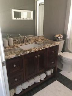 Maple Vanity In Espresso Stain With Yucatan Granite Top That Has Rich  Patterning And Mineral Deposits